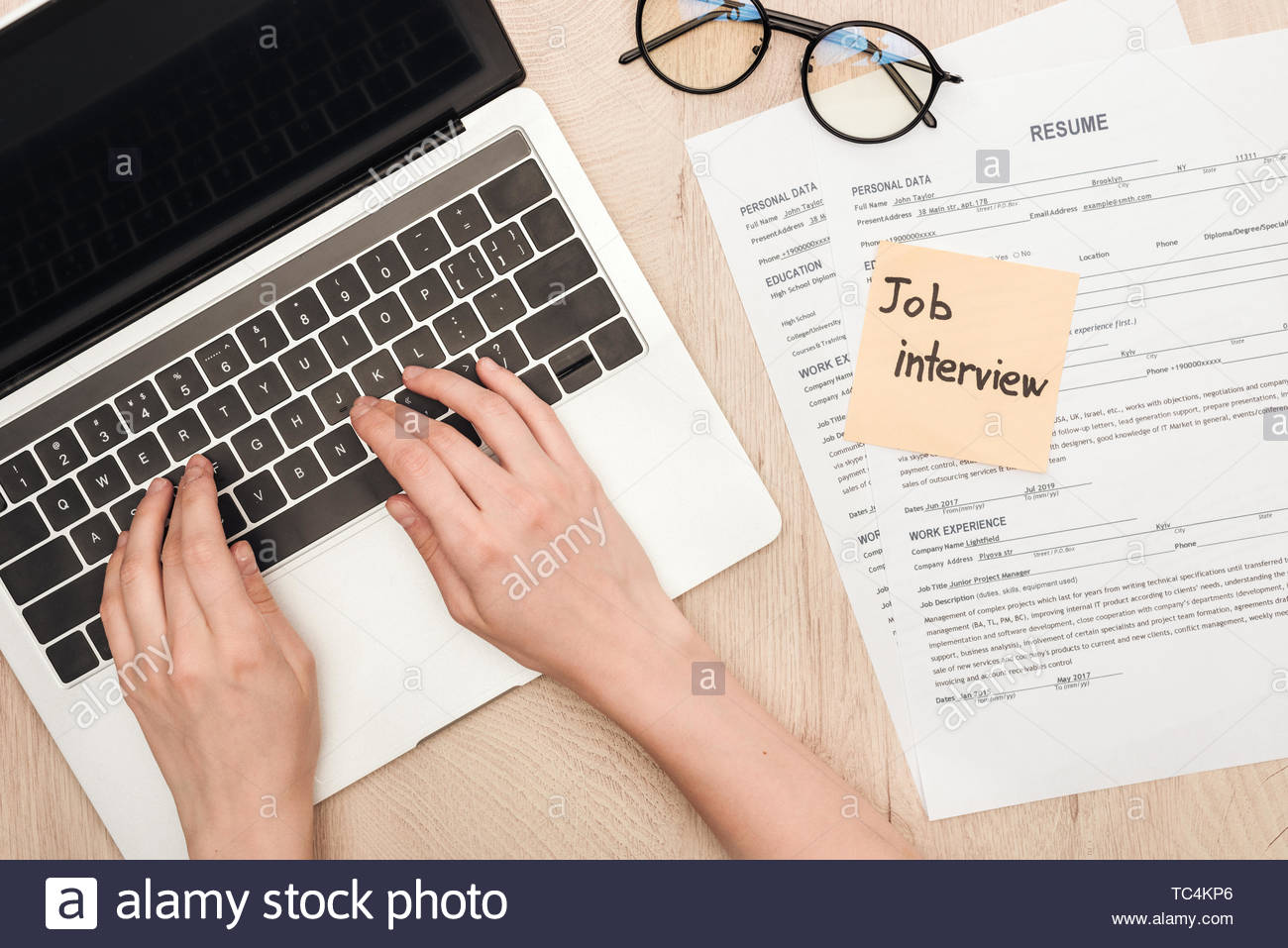 cropped view of recruiter typing on laptop keyboard glasses resume templates and sticky Resume Sticky Note Resume Template