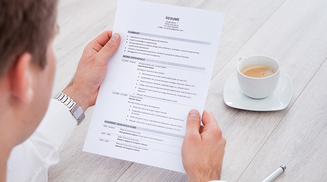 free resume databases for employers search quality candidates recruiter reviewing hair Resume Free Resume Search For Employers