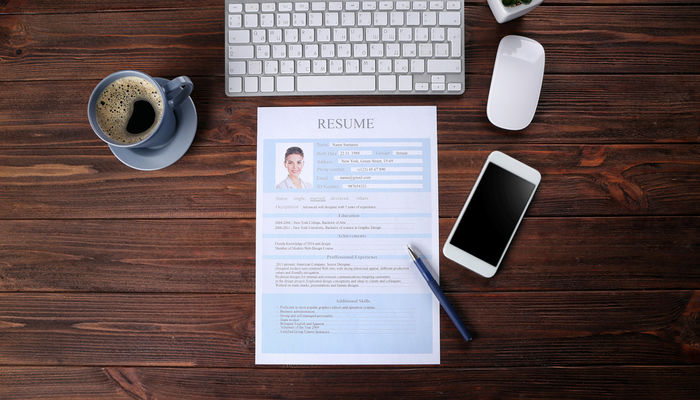 say cheese should you include photo in your cv on resume desk keyboard smartphone parsing Resume Should You Include A Picture On Your Resume