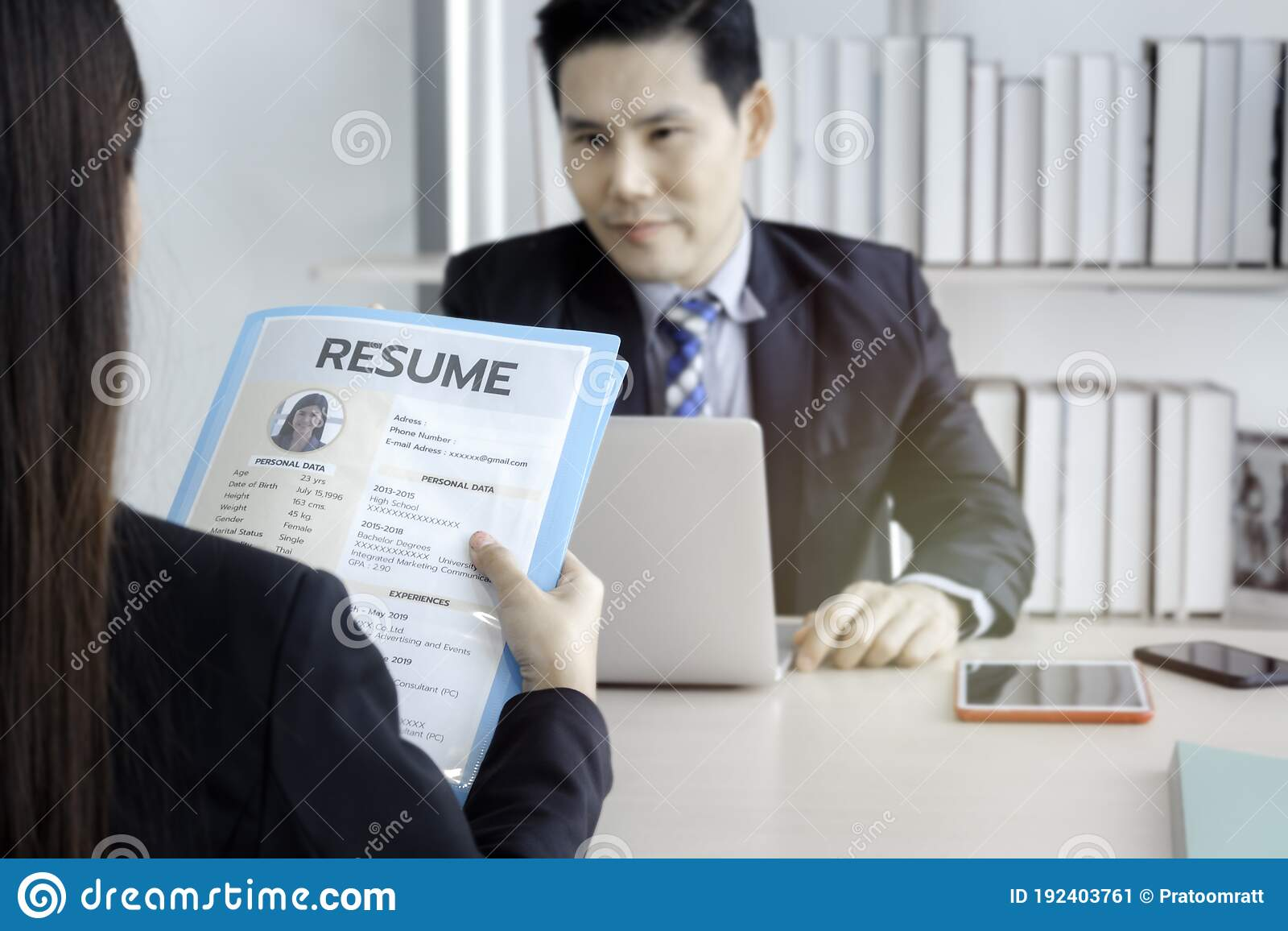 job interview concept woman holding her resume paper for giving to businessman manager Resume Resume Paper For Interview