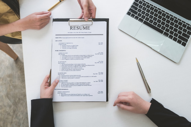 premium photo job interview in office concept focus on resume paper employer reviewing Resume Resume Paper For Interview